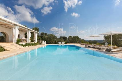 pool immersed in the vegetation of Ostuni