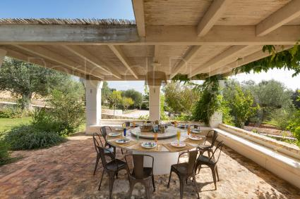 covered patio in the vegetation
