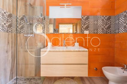 Orange bathroom with shower