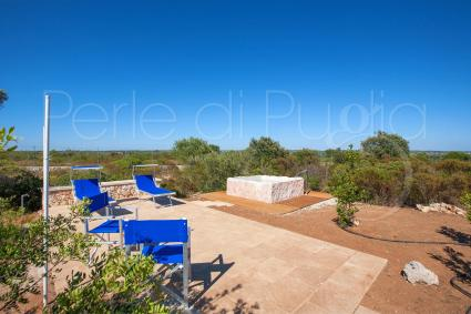 The solarium area near the stone pool allows you to relax outdoors