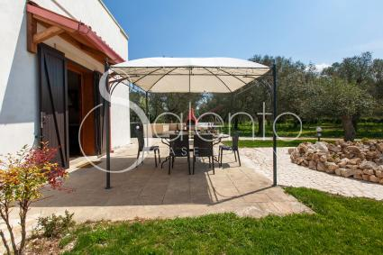 On the patio shaded by the gazebo to have lunche or dinner by preparing excellent barbecue grills