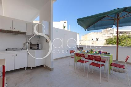 Balcony in the back, with kitchenette and dining area