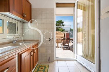well-equipped kitchenette with access to the verandah