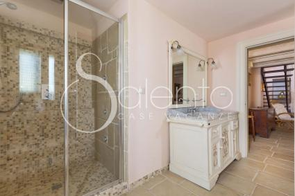 the large bathroom with shower