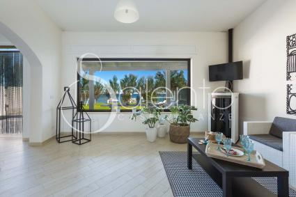 Living room with sea view, pellet heater and television