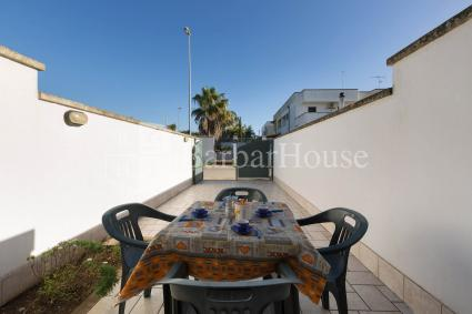 Furnished outdoor space with parking area