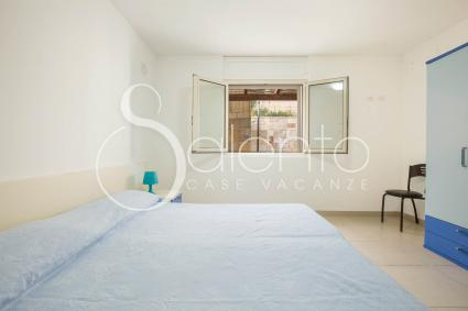 Master bedroom of the holiday home by the beach for rent