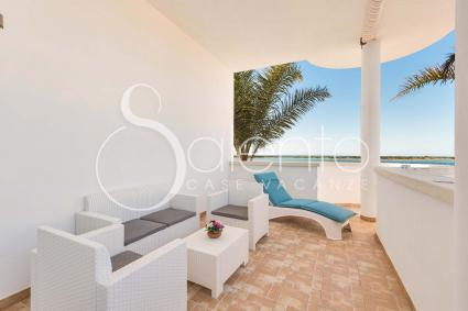 The terrace on the sea, with sofas, dining area and beach beds