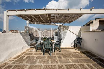 The beautiful terrace with panoramic view is covered and furnished