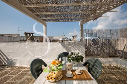 Having breakfast with the view on the roofs of a typical old town centre in Salento