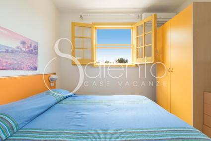 The bedroom of the holiday home for rent in Salento