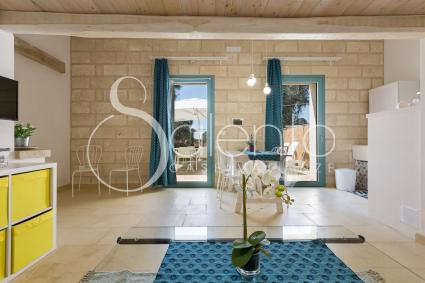 Wood, natural stone, pale shades in the holiday home for rent in Otranto