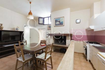The living room with kitchenette of the holiday home in Salento