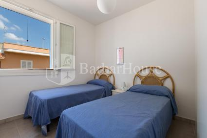 Twin bedroom of the apartment for rent by the sea of Nardò