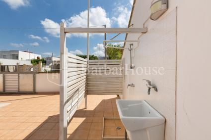 Shared outdoor area with shower and sink