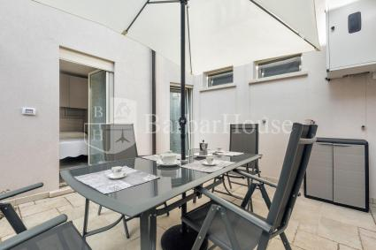 At the back of the one-bedroom apartment there is a furnished courtyard