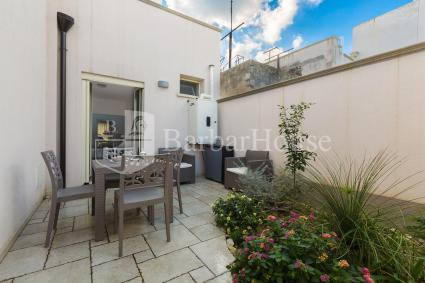 At the back of the apartment there is a furnished courtyard