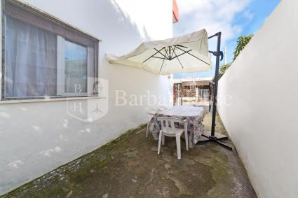 On the ground floor there`s an outdoor space furnished with a table and chairs