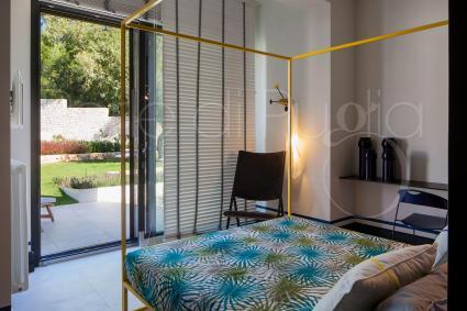 The sleeping area on the first floor consists of 3 en suite double bedrooms