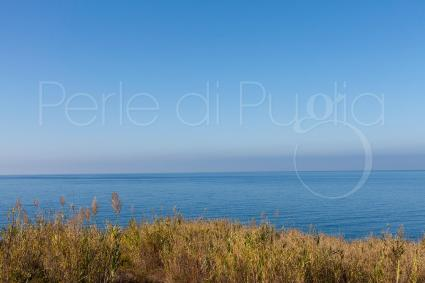 The blue sea of the Ionian coast just a stone`s throw from the villa