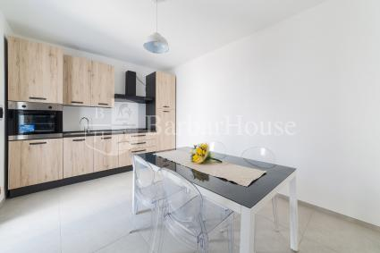 There is a spacious living room with a dining room and open kitchen