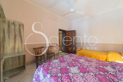 The bedroom is a triple with a double bed and a single bed