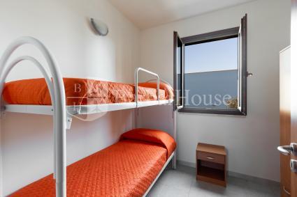 Camera doppia con letto a castello