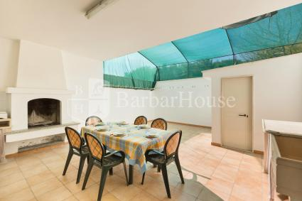 The holiday home has an outdoor area with barbecue