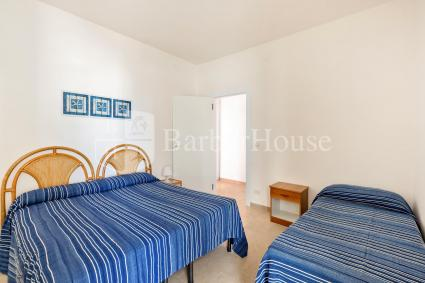 The second bedroom is a triple with a double bed and a single bed.