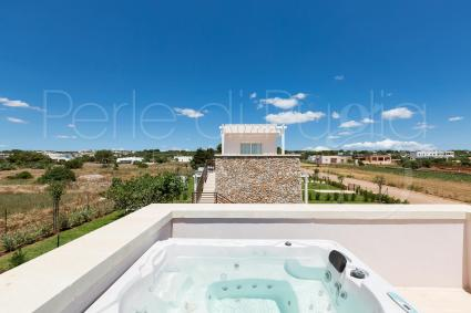 The luxury of a jacuzzi with view on the olive trees of Salento