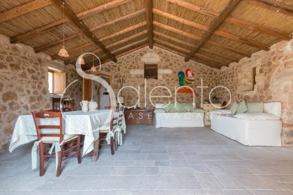 dining room with two sofa beds, entirely covered in local stones