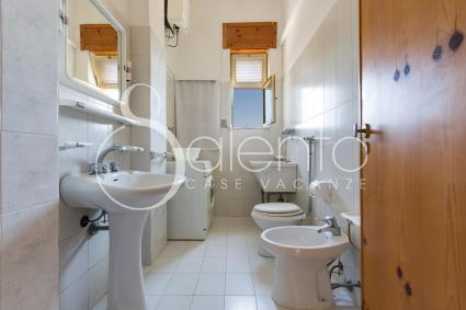 Half bath with sink and washing machine