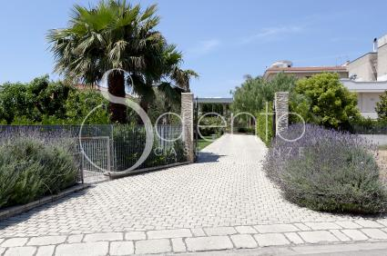 The automatic gate in the villa in the residential area of Aradeo